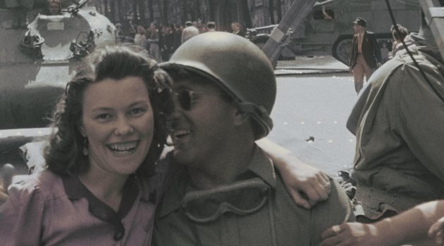 Paris, France: A young French woman hugs a American G.I. on the day of Liberation. Everything about them seems handsome. (Photo Credit: NARA)